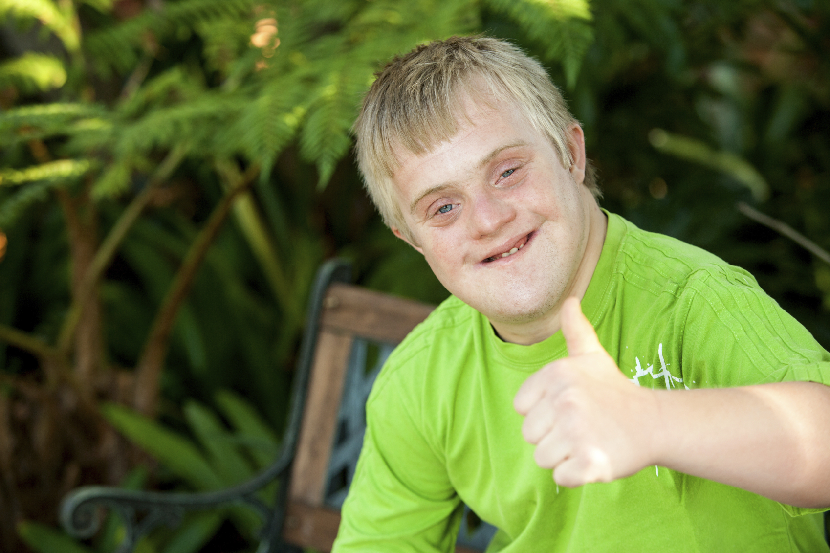 Person with Down Syndrome showing a thumbs up