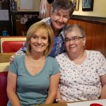 Nancy Mercer and two friends at a diner