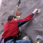 Person climbing a rock wall